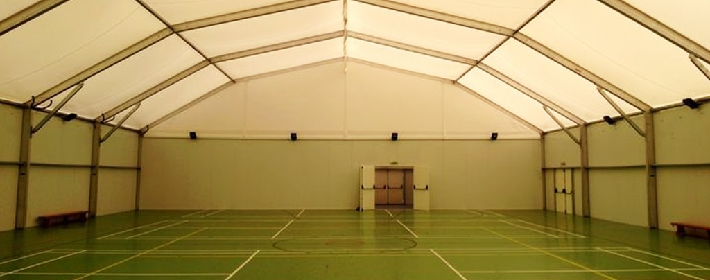 Inside temporary school sports hall